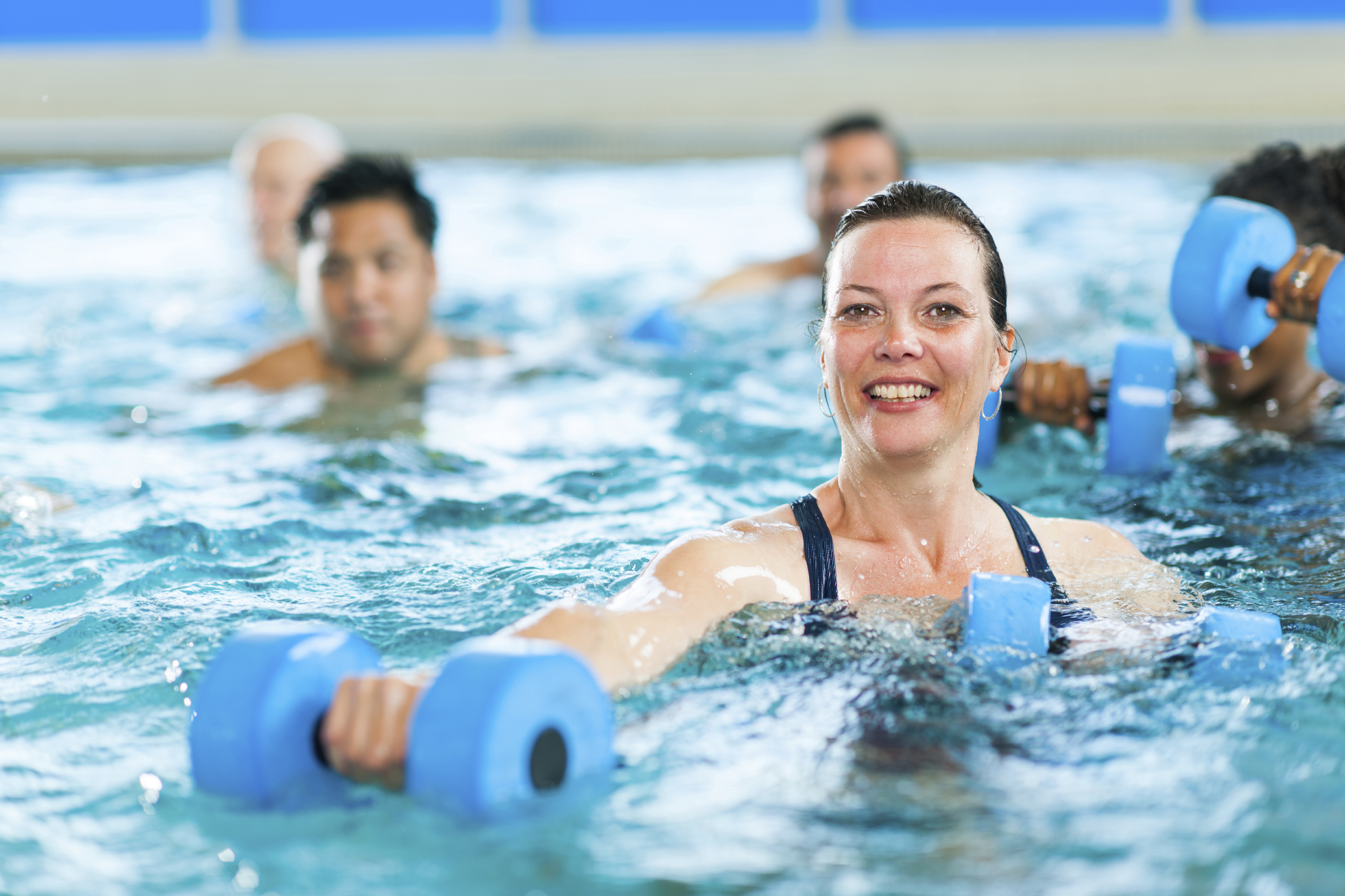 water aerobics Water aerobics is the performance of aerobic exercise in fairly shallow water  such as in a swimming pool done mostly vertically and without swimming  typically.