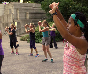Group of people participating in an outdoor Zumba class