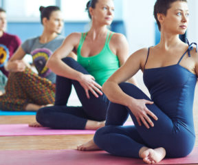 A few people participating in a group yoga class.