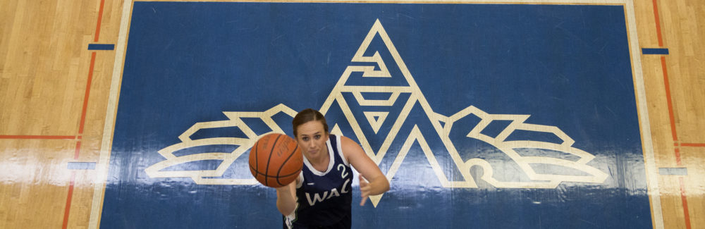 Meet the Athlete Katie McElree makes a lay up in the WAC gym.