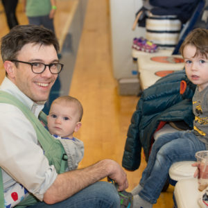 A dad and his two children in the 8th Floor gym at Family Fun Night February 2017.