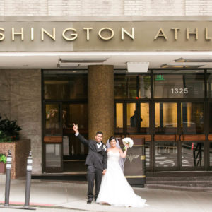Bride and groom standing in front of the Washington Athletic Club