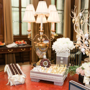 Table setting of snacks, gift tree, lamp and flowers