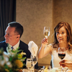 Wedding couple sitting at table