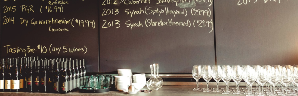 A chalkboard at Lobo Hills lists some of the wine vintages available.